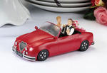 Caucasian Couple in Red Car Figurine Caketop